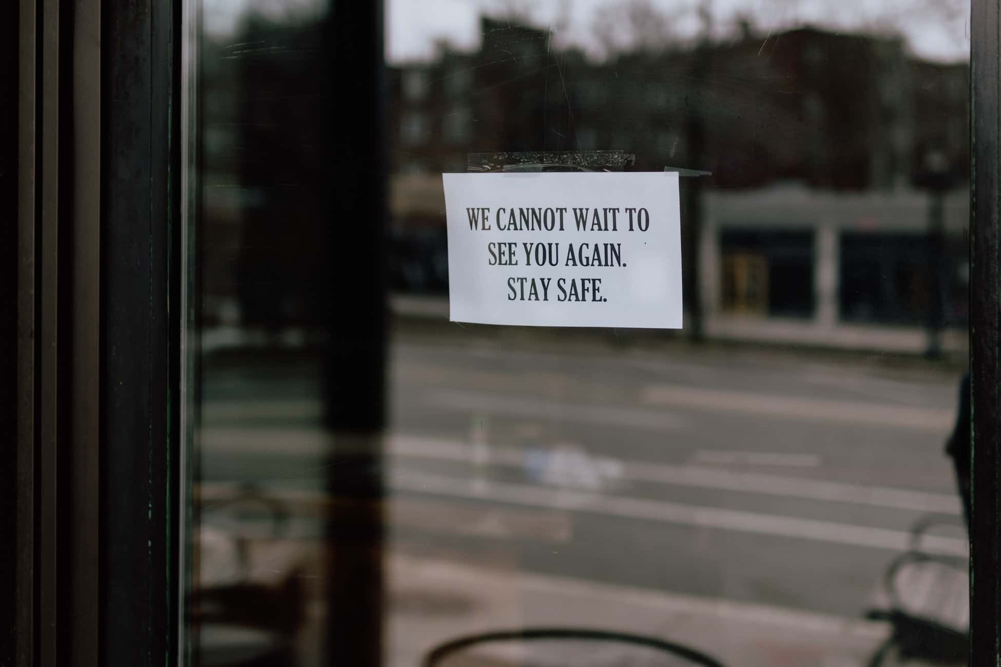 Sign in store window that reads